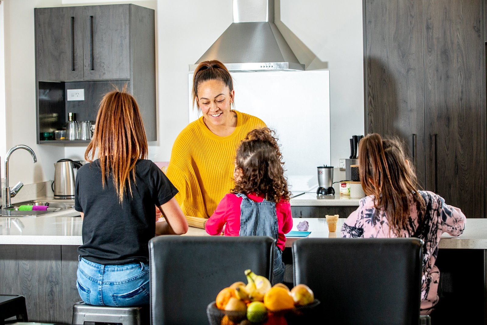 Terina Tawhai with her daughters Marcia-Kruz Tamati (left), Aroha Tamati (middle) and Elaine-Kelly Tamati inside their new whare in Hastings. Photo credit: Josie McClutchie.