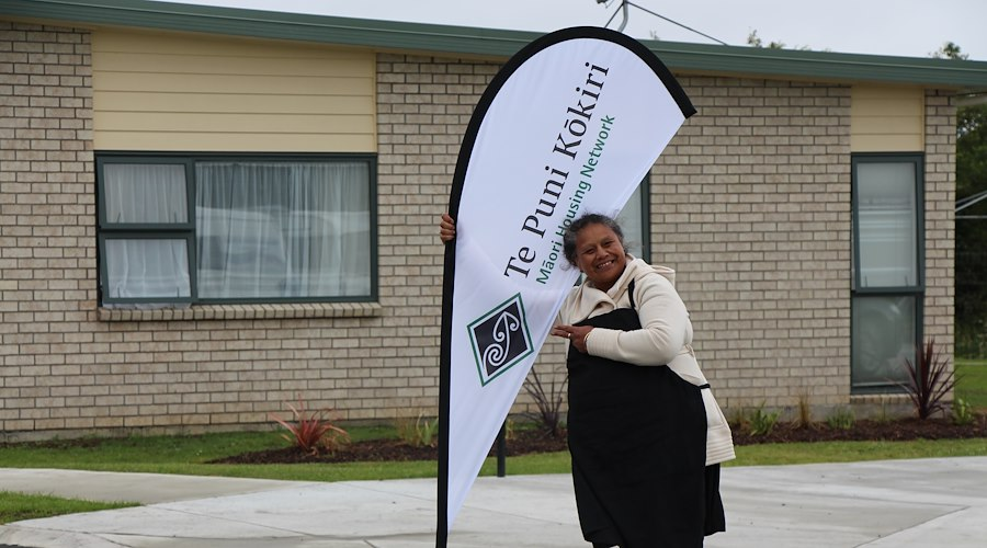One of the whānau posing at the Pūkaki Papakāinga opening in Auckland.