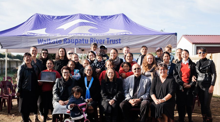 At the turning of the soil of the Turner Whānau Papakāinga, the whānau along with Regional Manager, Rachel Jones (front left) and Chief Executive, Michelle Hippolite (front right). Photographer: Erica Sinclair.